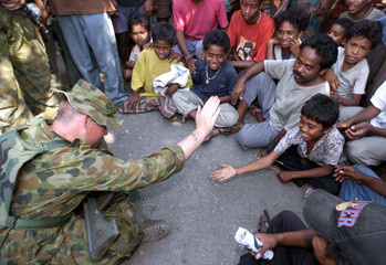 PEACEKEEPER PLAYS WITH CHILDREN IN OECUSSI.