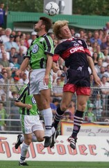 FC BAYERNS EFFENBERG AND NOWAK FROM WOLFSBURG FIGHT FOR BALL IN WOLFSBURG.