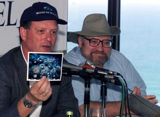 Undersea researcher Robert Ballard (L), who found the Titanic, holds June 23 a picture of ancient ju..