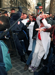 French psychiatric nurses are dispersed by baton-wielding riot police as they demonstrate outside a ..