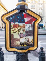 Decorative sign with historical images on Washington Street