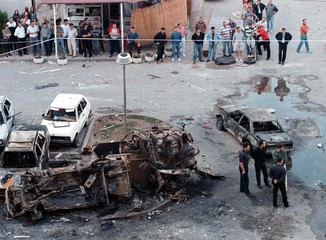 Croatian police stand in front of a destroyed car bomb in the centre of West Mostar September 19. Ab..