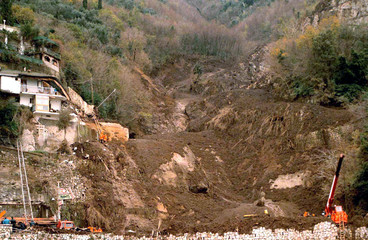 General view of a landslide January 11 which sent cars plunging into the sea on a coastal road south..