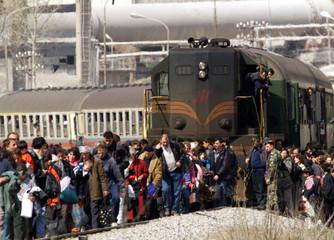 KOSOVAR REFUGEES WALK ON RAILWAY LINE TO MACEDONIA.