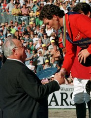 Germany's chancellor Helmut Kohl (L) congratulates Ludger Beerbaum after the last jump out of the Eu..