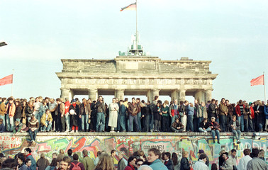 WEST BERLIN CITIZENS HOLD VIGIL ATOP THE BERLIN WALL IN THIS FILE PHOTO.