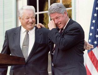 BILL CLINTON WIPES A TEAR AS HE LEANS ON BORIS YELTSIN.