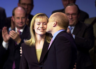 CONSERVATIVE LEADER WILLIAM HAGUE KISSES HIS WIFE FFION AFTER HIS CONFERENCE SPEECH.