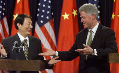 CLINTON AND ZHU AT PRESS CONFERENCE FOLLOWING MEETINGS.