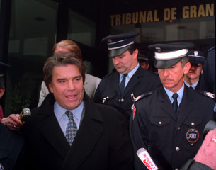 OM Marseille soccer team owner Bernard Tapie leaves the Valenciennes Tribunal Oct.19..