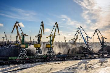 Cold winter morning. Port taps row along the coal handling terminal coastline.
