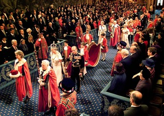 Britain's Queen Elizabeth II, accompanied by Prince Philip, walks through the Royal Gallery to the H..