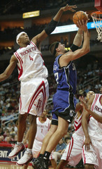 Houston Rockets forward Stromile Swift draws a foul as he defends the goal against Sacramento Kings center Brad Miller in Houston