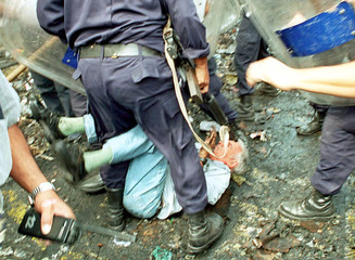 ARGENTINE POLICE BATTLE WITH PROTESTOR DURING DEMONSTRATION.