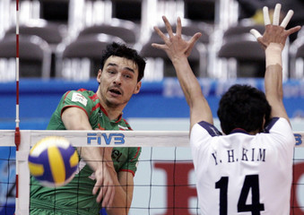 Bulgaria's Nikolov spikes the ball against South Korea's Kim during the third phase match of FIVB Men's Volleyball World Cup 2007 in Okayama