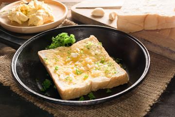 Home make Garlic bread by slice of bread.