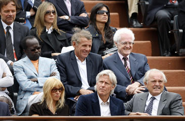 French Tennis Federation head Bimes and former Swedish tennis player Borg are seen at the French Open tennis tournament in Paris