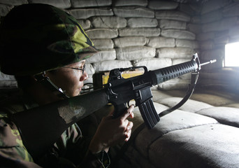 A civilian reserve soldier aims at a target in a war game in the northern county of Miaoli in Taiwan.