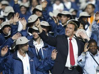 Governor of California Arnold Schwarzenegger walks together with the U.S. delegation during the opening ceremony for the Special Olympics in Shanghai