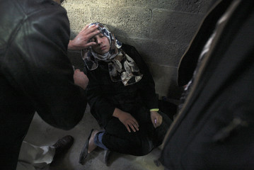 Relative of Palestinian Okal mourns during his funeral in Beit Lahiya