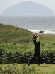 Goosen of South Africa  watches his tee shot during the British Open Golf Championship at the Turnberry Golf Club