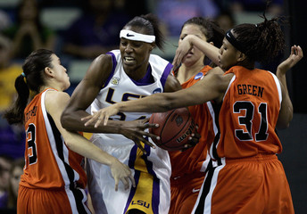 Louisiana State University center Fowles is swarmed by Oklahoma State University's defense during the second half of their NCAA Women's New Orleans Regional basketball game in New Orleans