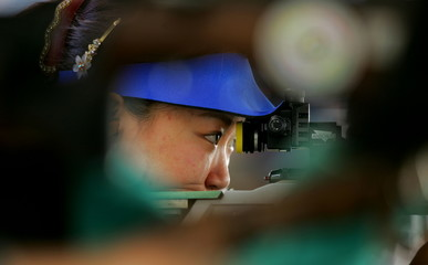 Chinese Olympic marksman Wu Liuxi practices in Athens August 12, 2004. China expects to win more tha..