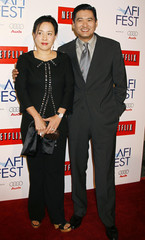 "Hong Kong actor Chow Yun-Fat and wife Jasmine Chow pose at the screening of his new film ""Curse of the Golden Flower"" at the AFI Fest 2006 in Hollywood"