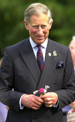 BRITAIN'S PRINCE OF WALES HOLDS A POSY OF FLOWERS AT THE OAKS HOSPICEIN ELGIN SCOTLAND.