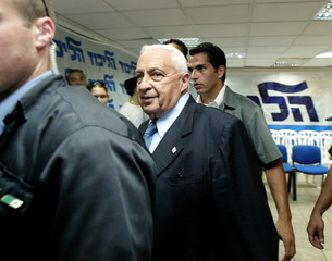 ISRAELI PRIME MINISTER, ARIEL SHARON ENTERS A CONFERENCE AT THE LIKUD PARTY CENTRE IN TEL AVIV.