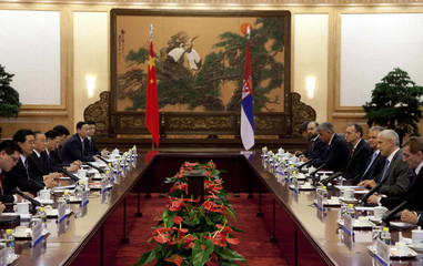 Serbia's President Boris Tadic listens to his Chinese counterpart Hu Jintao at a meeting at the Great Hall of the People in Beijing