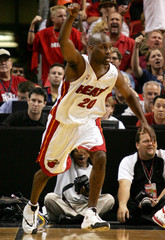 Miami Heat guard Payton celebrates three point shot against Lakers during NBA action in Miami