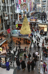 A Christmas tree is seen in the midst of shoppers in a major downtown shopping mall in Toronto