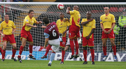 Aston Villa's Barry hits a free kick during their soccer match against Watford in Watford