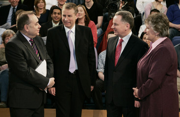 Scotland's political party leaders Salmond, Stephens, McConnell and Goldie stand together before taking part in a live television debate in Glasgow, Scotland