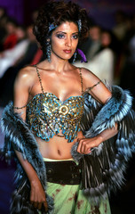 Model Randhawa presents a new creation by Indian designer Verma at a fashion show in Mumbai