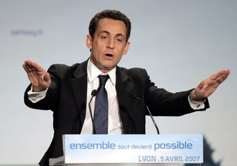 France's UMP party presidential candidate Nicolas Sarkozy delivers a campaign speech in Lyon