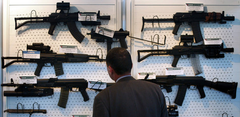 VISITOR LOOKS AT WEAPONS DURING DEFENCE EQUIPMENT EXHIBITION IN PLOVDIV.