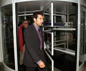 REAL MADRID'S PORTUGUESE STRIKER LUIS FIGO ARRIVES IN MUNICH FOR CHAMPIONS LEAGUE SEMIFINAL.