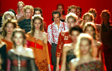 DESIGNER ROMEO GIGLI OF ITALY AT SPRING-SUMMER READY-TO-WEAR FASHIONSHOW IN PARIS.