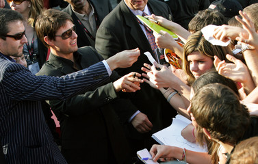 Hollywood star Cruise signs autographs at the world premiere of 'Mission: Impossible III' in Rome
