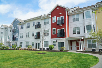 colorful apartment buildings and green front lawn in spring