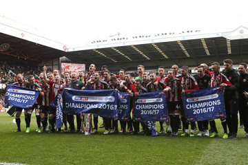 Sheffield United celebrate winning the league with the trophy