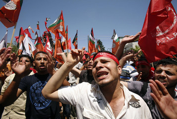 Palestinians take part in a demonstration in Gaza City