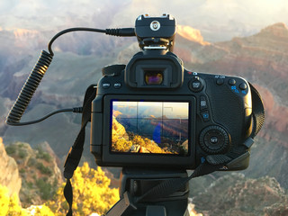 Photo camera in use at sunrise at Marther Point, Grand Canyon