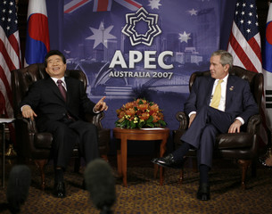U.S. President George W. Bush listens to South Korea's President Roh Moo-hyun during their bilateral meeting in Sydney