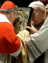 "Pope John Paul hands over the icon of the ""Mother of God of Kazan"" to Cardinal Walter Kasper ..."