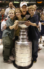 NEW JERSEY DEVILS MARTIN BRODEUR CELEBRATES WITH SONS.