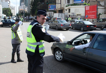 A French policeman helps his Lebanese counterpart direct traffic during a training exercise in Beirut