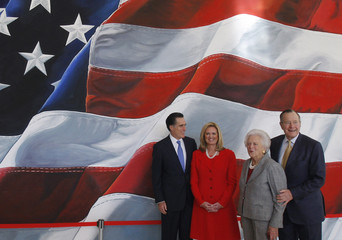 Republican presidential candidate former Massachusetts Governor Romney, his wife Ann, former first lady Barbara, and former president Bush pose for a picture in College Station